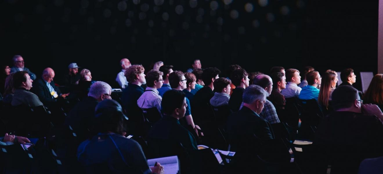 A crowd of people at a tech event