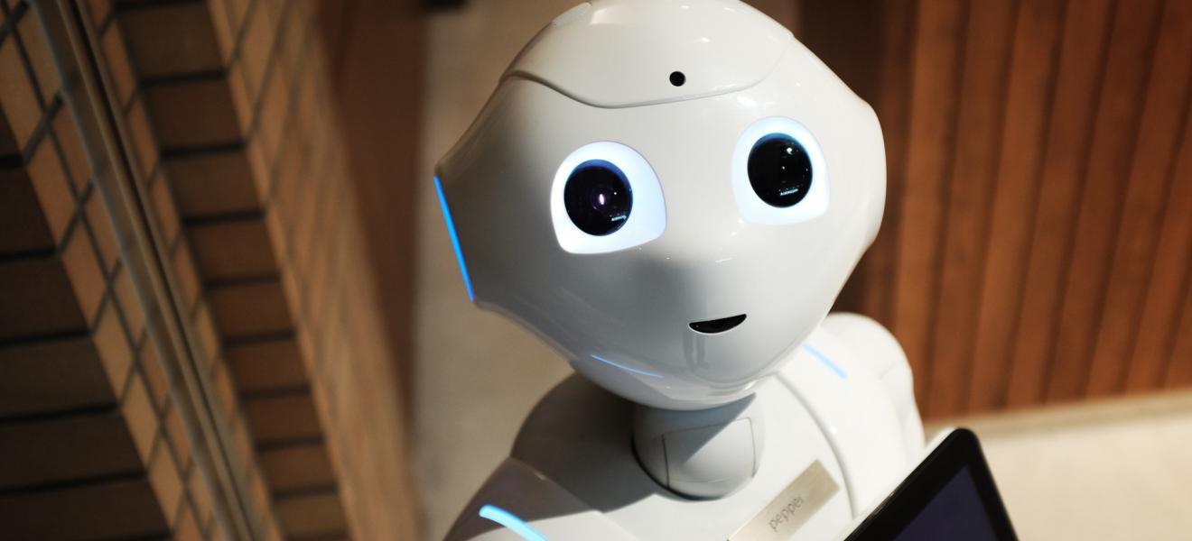 Cute Robot looking up with big eyes