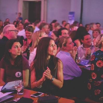 The crowd at a recent Bristol Technology Festival event, clapping and looking at the stage