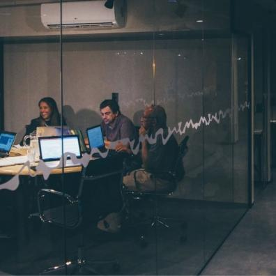 A group of young people in a shared office space