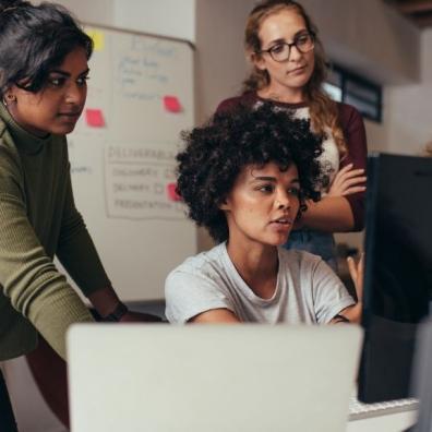 Three professionals using a computer
