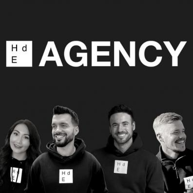 The HdE Agency staff with their logo above