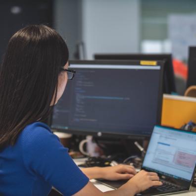 Person programming at computer